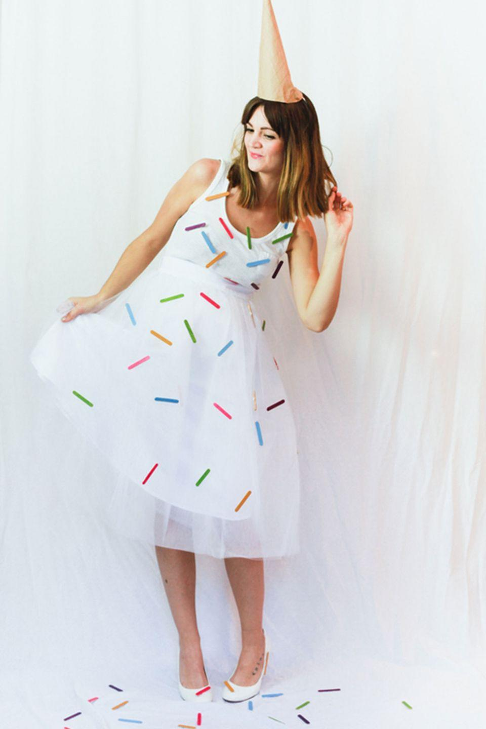 """<p>I scream, you scream, we all scream for this sweet costume idea.</p><p><strong>Get the tutorial at <a href=""""http://treasuresandtravelsblog.com/blog/2014/10/24/halloween-costumes-ice-cream-cotton-candy"""" rel=""""nofollow noopener"""" target=""""_blank"""" data-ylk=""""slk:Treasures and Travels"""" class=""""link rapid-noclick-resp"""">Treasures and Travels</a>. </strong></p>"""