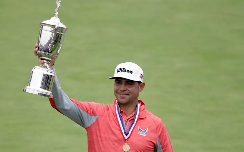Gary Woodland celebrates with the trophy after winning the U.S. Open Championship golf tournament - AP