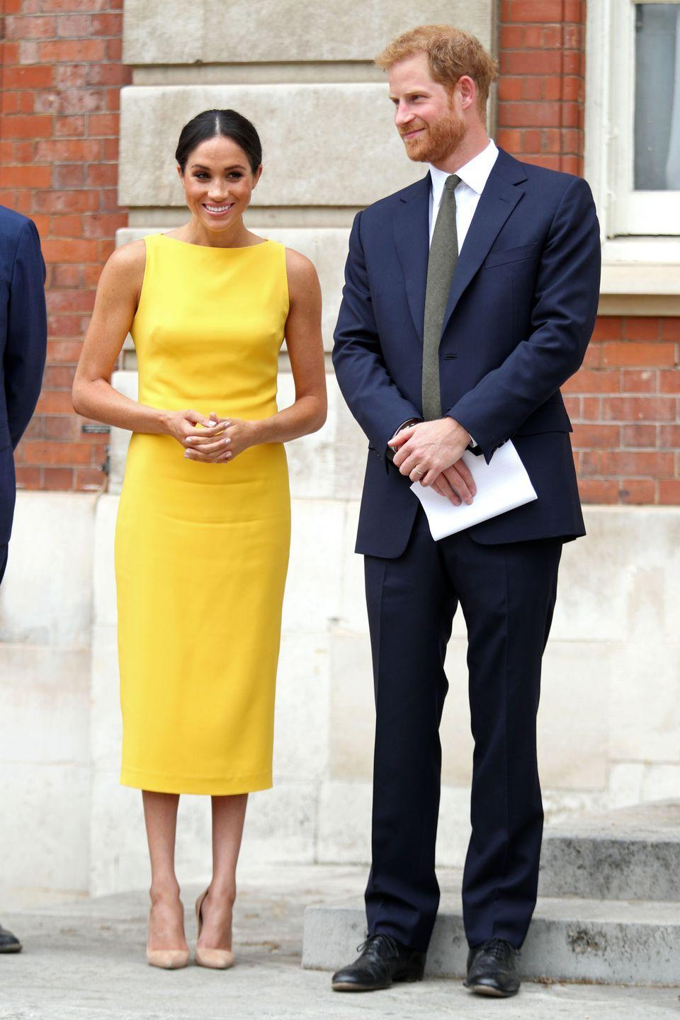 <p>Meghan Markle opted for a sleeveless yellow Brandon Maxwell midi dress for a Commonwealth Youth event, which had a boat neck reminiscent of her Givenchy wedding dress. </p>