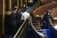 U.S. Capitol Police with guns drawn stand near a barricaded door as rioters try to break into the House Chamber at the U.S. Capitol on Wednesday, Jan. 6, 2021, in Washington. (AP Photo/Andrew Harnik)