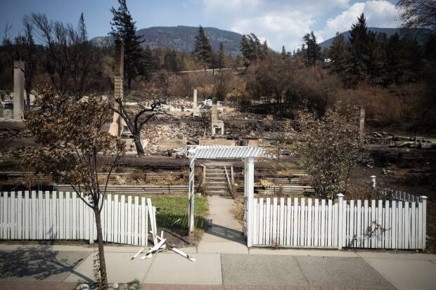 Damaged structures are seen in Lytton, B.C., on July 9 after a wildfire destroyed most of the village on June 30. (Darryl Dyck/The Canadian Press - image credit)