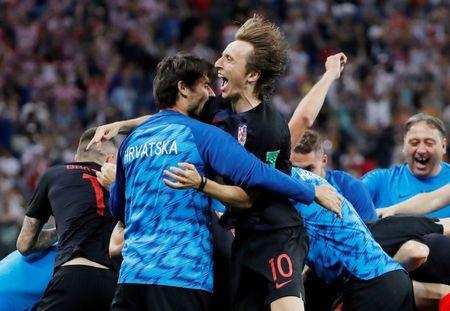 Croatia's Luka Modric and teammates celebrate after winning the penalty shootout. REUTERS/Carlos Barria