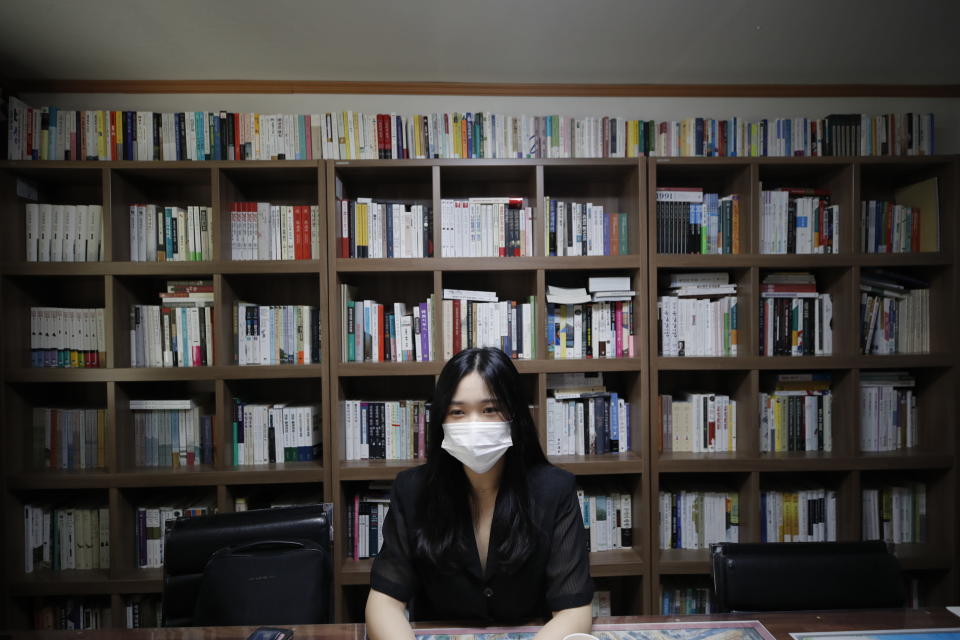 "Han Shin Bi, a high school senior in Seoul, wearing a face mask speaks during an interview in Seoul, South Korea, on Sept. 18, 2020. ""Online classes were really inconvenient,"" said Han. Experts say the reduced interaction with teachers, digital distractions and technical difficulties are widening the education achievement gap among students in South Korea, leaving those less well off, like Han, at even more at a disadvantage. (AP Photo/Lee Jin-man)"