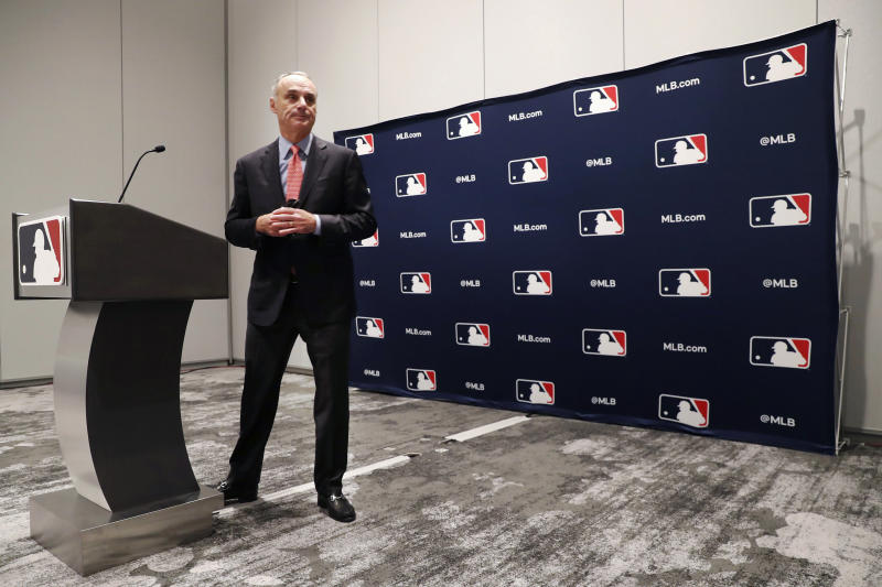 Baseball commissioner Rob Manfred steps away from the podium after speaking to the media at the owners meeting in Arlington, Texas, Thursday, Nov. 21, 2019. (AP Photo/LM Otero)