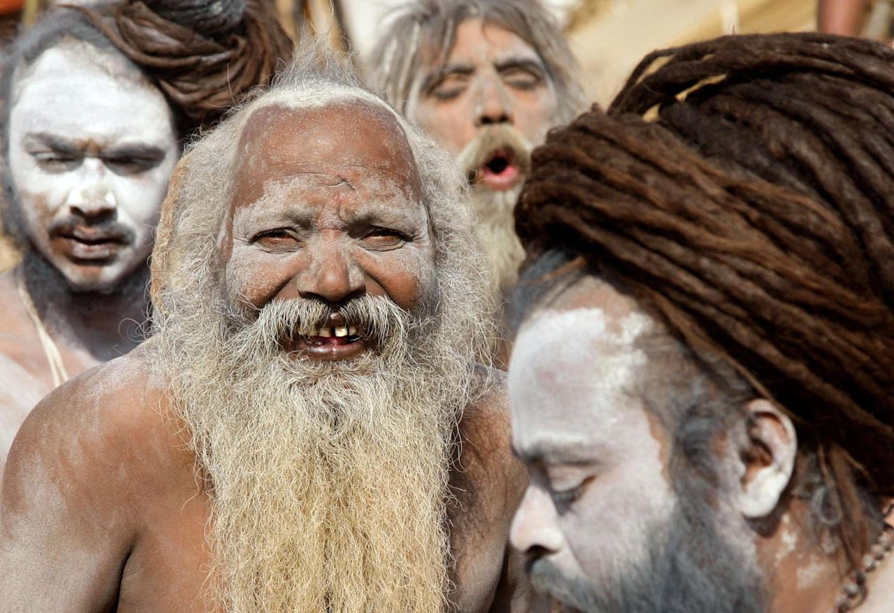 "Hindu holy men, also known as ""Sadhus"", take part in a procession to attend the ""Kumbh Mela"", or Pitcher Festival, in the northern Indian city of Allahabad December 18, 2012. During the festival, hundreds of thousands of Hindus take part in a religious gathering at the banks of the river Ganges. The festival is held every 12 years in different Indian cities. REUTERS/Jitendra Prakash (INDIA - Tags: RELIGION SOCIETY)"