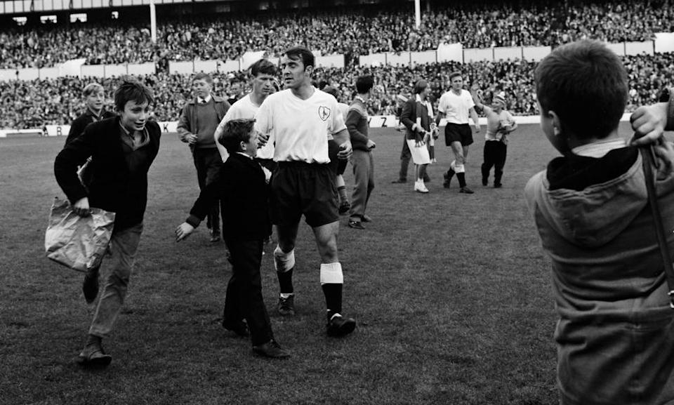Jimmy Greaves, centre, is approached by a young spectators following Tottenham Hotspur's 6-2 victory over Manchester United in October 1962