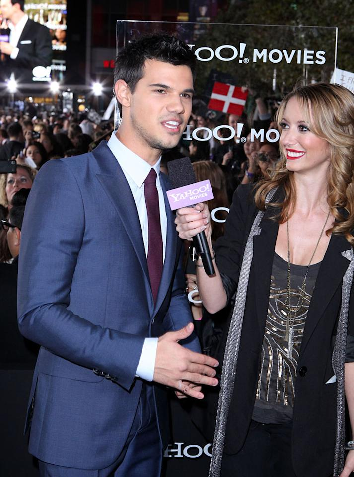 "<p class=""MsoNoSpacing"">Taylor Lautner is interviewed by Yahoo! Movies at the red carpet premiere for ""The Twilight Saga: Breaking Dawn – Part 1"" in Los Angeles, CA. (Photo by Nelson Blanton/Yahoo!)</p>"