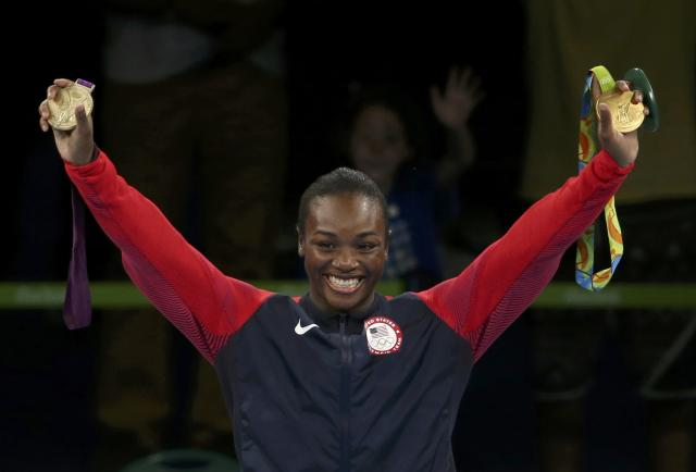 2016 Rio Olympics - Boxing - Victory Ceremony - Women's Middle (75kg) Victory Ceremony - Riocentro - Pavilion 6 - Rio de Janeiro, Brazil - 21/08/2016. Gold medallist Claressa Shields (USA) of USA poses with her medals from London 2012 and Rio 2016 (R). REUTERS/Matthew Childs FOR EDITORIAL USE ONLY. NOT FOR SALE FOR MARKETING OR ADVERTISING CAMPAIGNS.