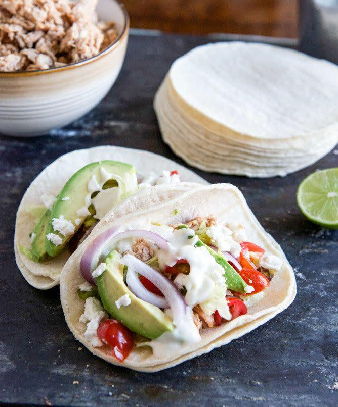"<strong>Get the recipe for <a href=""http://www.howsweeteats.com/2013/03/smokey-roasted-chicken-tacos-with-spicy-goat-cheese-queso/"" rel=""nofollow noopener"" target=""_blank"" data-ylk=""slk:smoky roasted chicken tacos with spicy goat cheese queso"" class=""link rapid-noclick-resp"">smoky roasted chicken tacos with spicy goat cheese queso</a> by How Sweet Eats.</strong>"