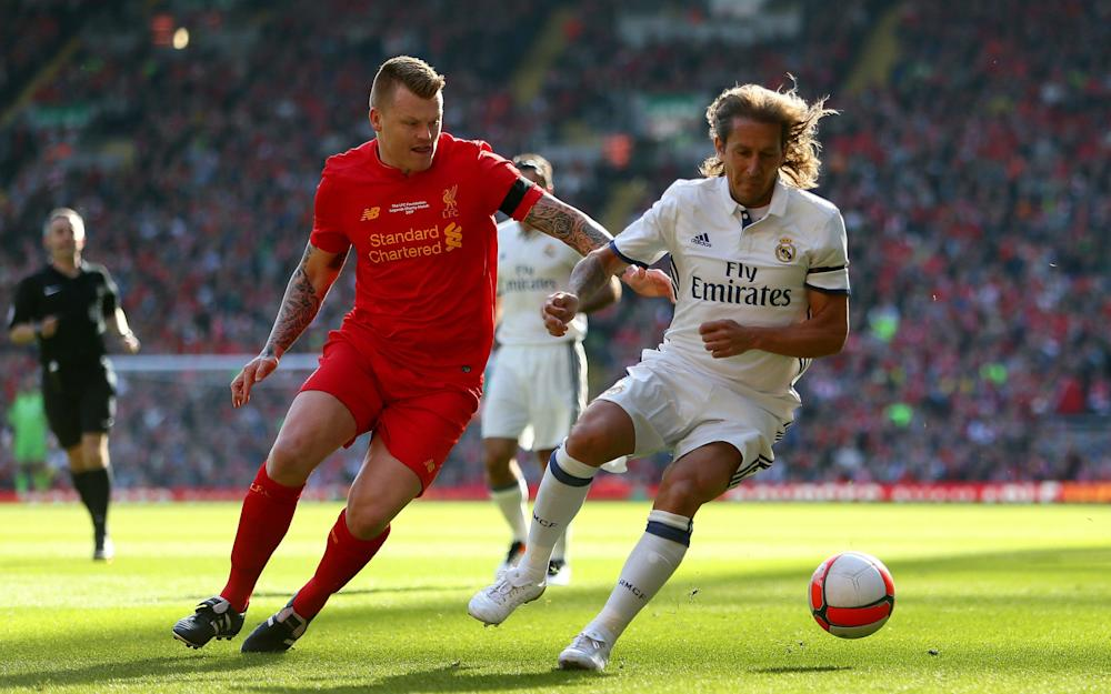 Liverpool's John Arne Riise (left) and Real Madrid's Michel Salgado battle for the ball during the charity match at Anfield, - Credit: PA