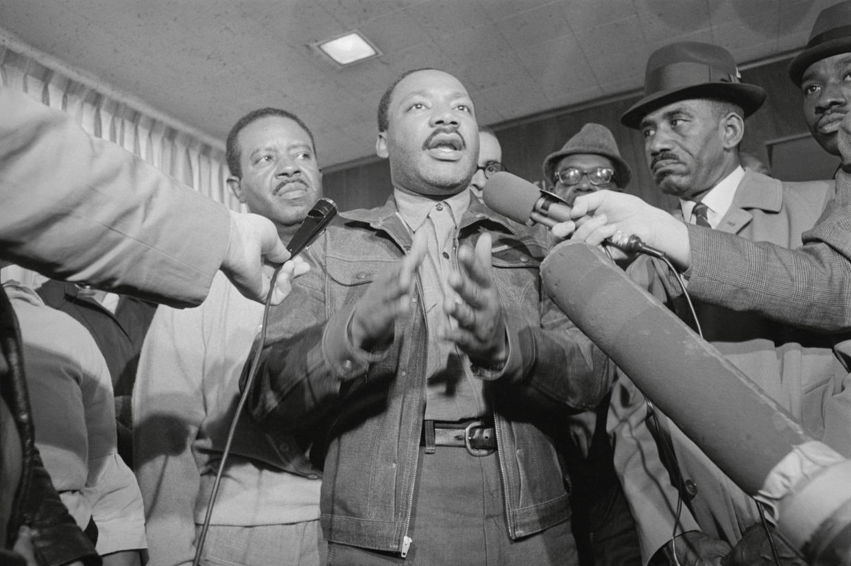 King and the Rev. Ralph Abernathy, left, are met by reporters as they emerge from the Jefferson County jail in Birmingham, Ala., on Nov. 6, 1967. (Photo: Bettmann/Getty Images)