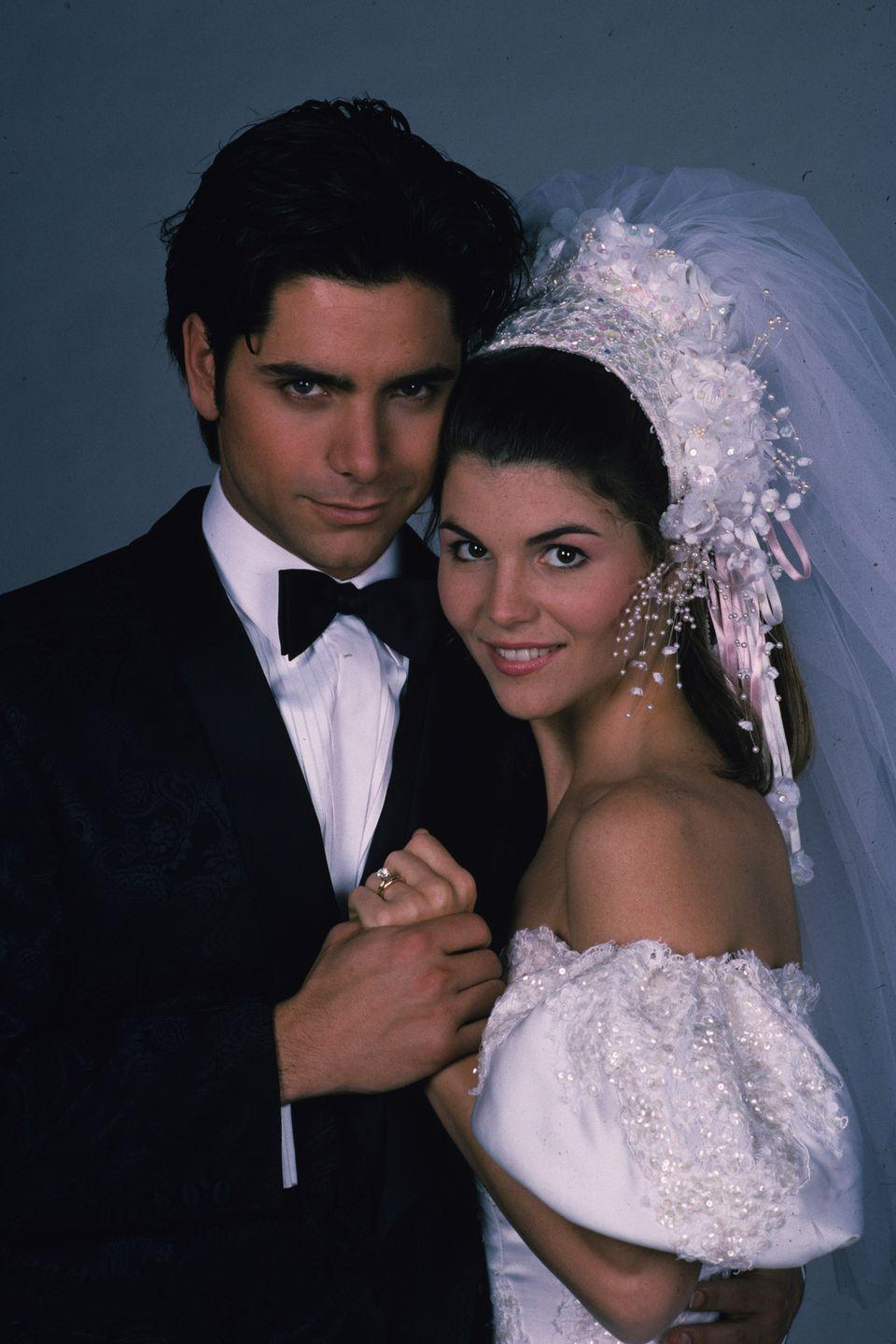 <p>Becky and Jesse were a couple just meant to be on <em>Full House – </em>Jesse was the motorcycle jacket-wearing ladies' man while Becky was the put-together news show host. The pair tied the knot in season 4, when Becky wore this off-the-shoulder puff-sleeve gown. </p>