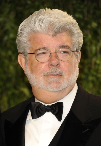 "FILE - In this Feb. 26, 2012 file photo, George Lucas arrives at the Vanity Fair Oscar party in West Hollywood, Calif. A decade after George Lucas said ""Star Wars"" was finished on the big screen, a new trilogy is destined for theaters after The Walt Disney Co. announced Tuesday, Oct. 30, 2012, that it was buying Lucasfilm Ltd. for $4.05 billion. (AP Photo/Evan Agostini, File)"