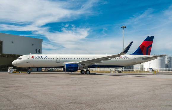 A Delta Air Lines jet parked on the tarmac during the day