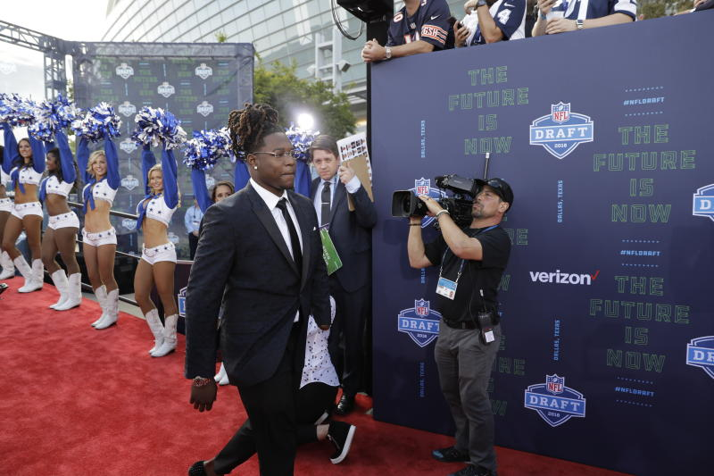 UCF's Shaquem Griffin, strolling down the red carpet at the NFL draft on Thursday, had to wait a bit for his name to be called. (AP)