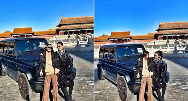 Two people with an SUV in Forbidden City, Beijing.