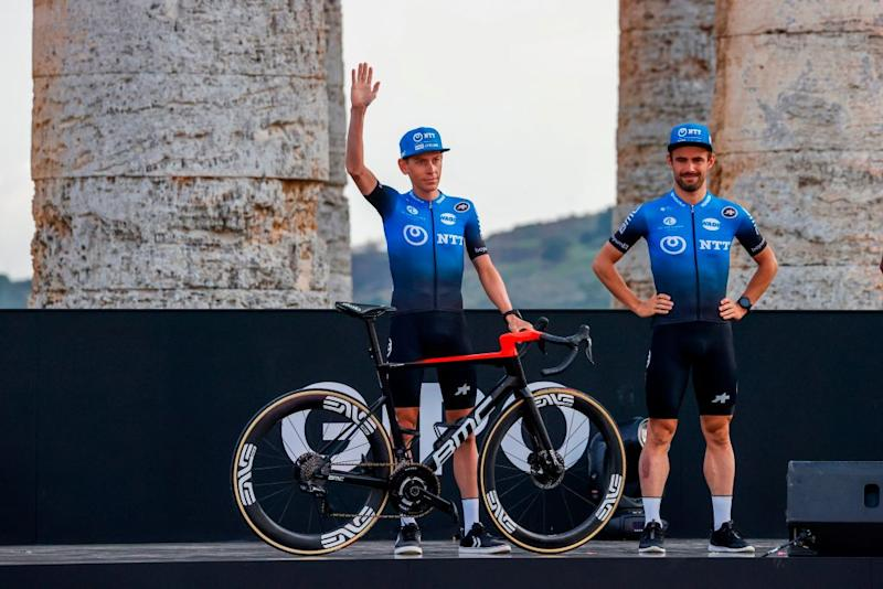 South Africas Louis Meintjies L of NTT Pro Cycling Team waves on stage at the Doric Temple of Segesta near Palermo Sicily on October 1 2020 during an opening ceremony of presentation of participating teams and riders two days ahead of the departure of the Giro dItalia 2020 cycling race Photo by Luca Bettini AFP Photo by LUCA BETTINIAFP via Getty Images