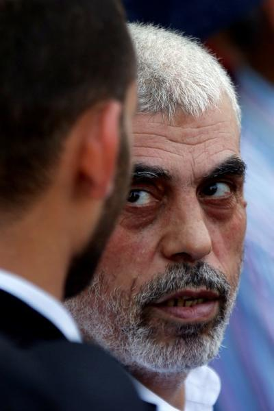 FILE PHOTO: Hamas Gaza Chief Yehya Al-Sinwar looks on as he takes part in a protest against Bahrain's workshop for U.S. Middle East peace plan, in Gaza City