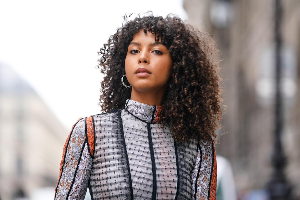 """Add some dimension to curly hair with super-short, face-framing fringe (yes, <a href=""""https://www.glamour.com/story/how-to-style-bangs-best-tips?mbid=synd_yahoo_rss"""" rel=""""nofollow noopener"""" target=""""_blank"""" data-ylk=""""slk:all hair textures"""" class=""""link rapid-noclick-resp"""">all hair textures</a> can pull them off)."""
