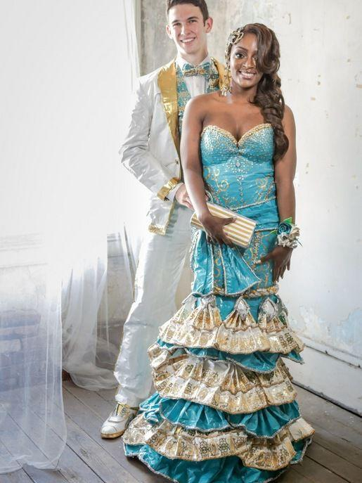 """<p>Ronnita and her date's ensemble required over 90 rolls of duct tape and 400 hours to complete. Even her accessories - including her corsage, earrings, clutch, headpiece, and nail art - are made from tape! She took <a href=""""http://stuckatprom.com/past-winners/2014/ronnita-joseph/"""" rel=""""nofollow noopener"""" target=""""_blank"""" data-ylk=""""slk:second place"""" class=""""link rapid-noclick-resp"""">second place</a> in Duck Tape's 2014 contest.</p>"""