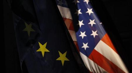 An EU flag and an U.S. flag are pictured in Berlin