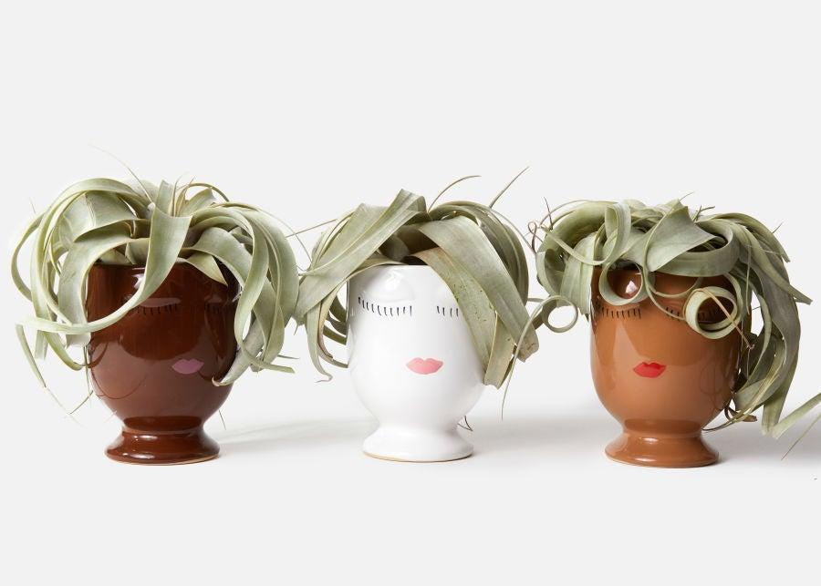 """<h3><h2>Air Plant</h2></h3><br><strong>Why She'll Love It</strong><br>This jumbo-sized air plant comes packaged in a painted-face ceramic planter for an extra-special gifting flourish.<br><br><strong>Care</strong><br>Airplant care consists of placing the low-maintenance green friend wherever your heart desires and giving it a quick water-mist two to three times per week.<br><br><em>Shop</em><strong><em> <a href=""""https://urbanstems.com/plants"""" rel=""""nofollow noopener"""" target=""""_blank"""" data-ylk=""""slk:UrbanStems"""" class=""""link rapid-noclick-resp"""">UrbanStems</a></em></strong> <br><br><strong>Urbanstems</strong> The Cathy Airplant, $, available at <a href=""""https://go.skimresources.com/?id=30283X879131&url=https%3A%2F%2Furbanstems.com%2Fproducts%2Fplants%2Fthe-cathy%2FNF-K-00015-1.html"""" rel=""""nofollow noopener"""" target=""""_blank"""" data-ylk=""""slk:Urbanstems"""" class=""""link rapid-noclick-resp"""">Urbanstems</a>"""