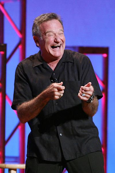 """This Nov. 23, 2009 photo released by Starpix shows actor-comedian Robin Williams performing his stand-up show, """"Weapons of Self Destruction,"""" at Town Hall in New York. Williams' wife Susan Schneider released a statement Thursday, Aug. 14, 2014 announcing that Williams had early stages of Parkinson's disease. He died Monday of an apparent suicide at the age of 63. (AP Photo/Starpix, Dave Allocca)"""