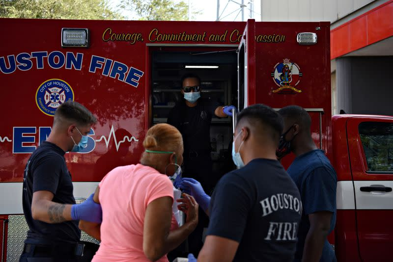 Members of the Houston Fire Department work amidst the COVID-19 pandemic in Houston