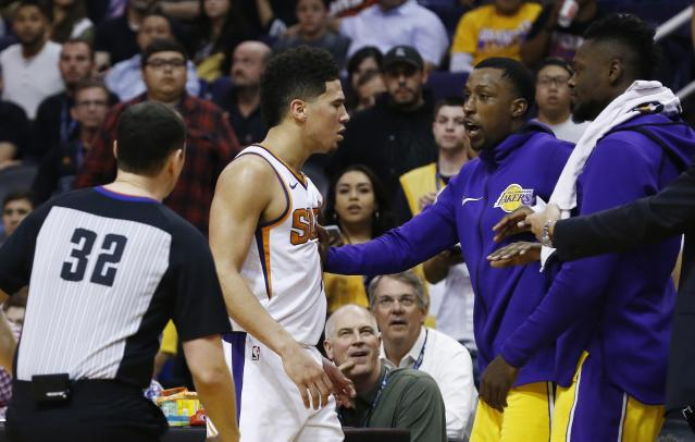 "Suns sensation <a class=""link rapid-noclick-resp"" href=""/nba/players/5473/"" data-ylk=""slk:Devin Booker"">Devin Booker</a> approaches the Lakers' bench. (AP)"