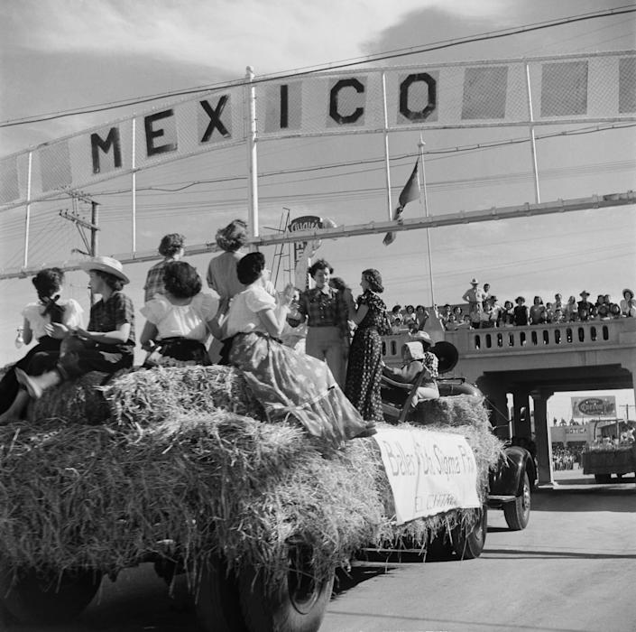 A view of the Sigma Pi sorority crossing under the Mexico border sign to Tijuana, Mexico in Calexico, California.