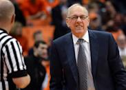 Syracuse coach Jim Boeheim taks with an official during the second half of an NCAA college basketball game against Colgate in Syracuse, N.Y., Monday, Dec. 22, 2014. (AP Photo/Kevin Rivoli)