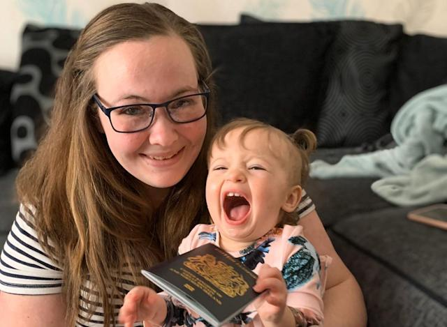 Danielle Hugman, 25, with her one-year-old Willow-Rose, and her new blue passport. (SWNS)