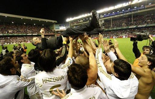 Real Madrid's players toss coach Jose Mourinho after winning the Spanish league title