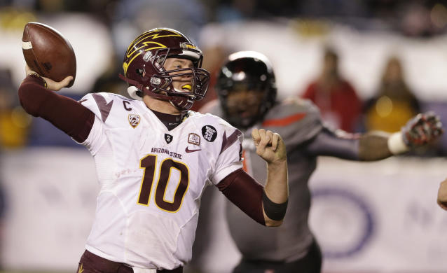 Arizona State quarterback Taylor Kelly (10) throws a pass while playing Texas Tech in the second half during the Holiday Bowl NCAA college football game Monday, Dec. 30, 2013, in San Diego. (AP Photo/Gregory Bull)
