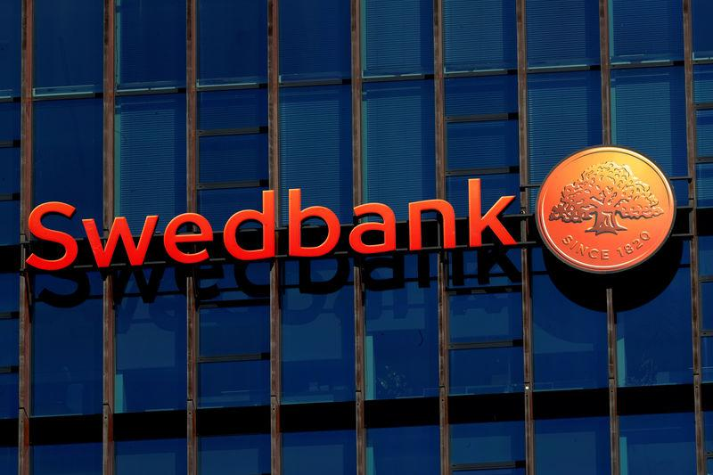 FILE PHOTO: Swedbank sign is seen on the building of the bank's Lithuanian headquarters in Vilnius