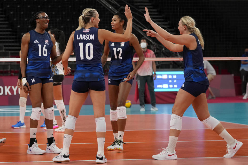 United States' players celebrate winning a point during the women's volleyball preliminary round pool B match between United States and Argentina at the 2020 Summer Olympics, Sunday, July 25, 2021, in Tokyo, Japan. (AP Photo/Frank Augstein)
