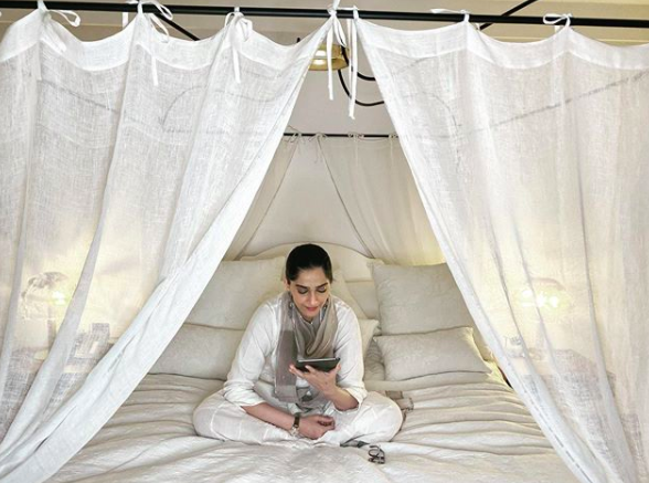 Sonam Kapoor catches up on some reading from her bedroom.