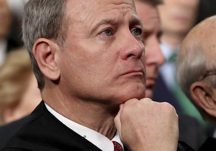 FILE - In this Tuesday, Jan. 30, 2018 file photo, U.S. Supreme Court Chief Justice John Roberts listens as President Donald Trump delivers his first State of the Union address in the House chamber of the U.S. Capitol to a joint session of Congress in Washington. Supreme Court Chief Justice John Roberts is using his annual report on the federal judiciary to highlight the steps the branch has taken to combat inappropriate conduct in the workplace. (Win McNamee/Pool via AP)