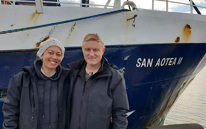 Neville and Feeonaa Clifton are pictured by the San Aotea II fishing boat in the Falkland Islands - Feeonaa Clifton