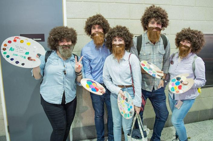 """<p>How many Bob Rosses is too many Bob Rosses? The limit does not exist, which is why a Bob Ross group costume is truly a work of art. </p><p><a class=""""link rapid-noclick-resp"""" href=""""https://www.amazon.com/California-Costumes-Joyful-Painter-Moustache-Standard/dp/B07RKG4382?tag=syn-yahoo-20&ascsubtag=%5Bartid%7C10070.g.3083%5Bsrc%7Cyahoo-us"""" rel=""""nofollow noopener"""" target=""""_blank"""" data-ylk=""""slk:SHOP BOB ROSS ACCESSORIES"""">SHOP BOB ROSS ACCESSORIES</a></p>"""