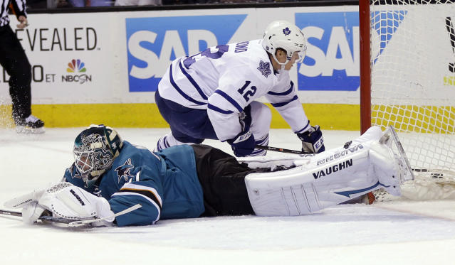 San Jose Sharks goalie Antti Niemi (31) stops a shot attempt by Toronto Maple Leafs' Mason Raymond (12) during the second period of an NHL hockey game Tuesday, March 11, 2014, in San Jose, Calif. (AP Photo/Marcio Jose Sanchez)