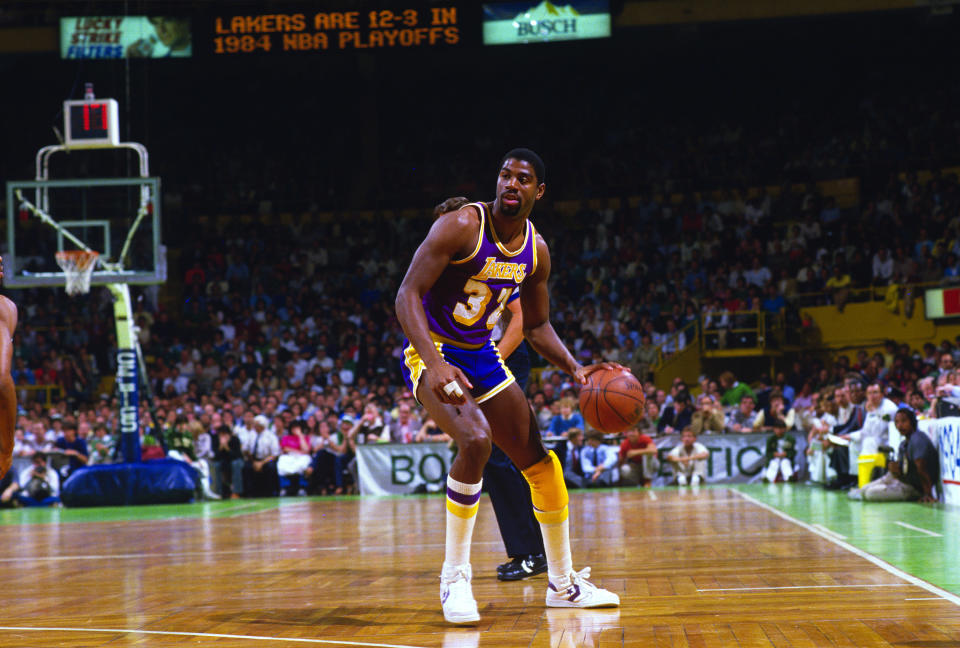 BOSTON, MA - JUNE 1984: Earvin Magic Johnson #32 of the Los Angeles Lakers dribbles the ball up court against the Boston Celtics during the 1984 NBA Basketball Finals at the Boston Garden in Boston, Massachusetts. The Celtics won the Championship 4 games to 3.  Johnson played for the Lakers from 1979-91 and 96. (Photo by Focus on Sport/Getty Images)