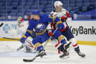 Buffalo Sabres forward Jeff Skinner (53) and Washington Capitals defenseman Justin Schultz (2) vie for position during the second period of an NHL hockey game Thursday, Jan. 14, 2021, in Buffalo, N.Y. (AP Photo/Jeffrey T. Barnes)