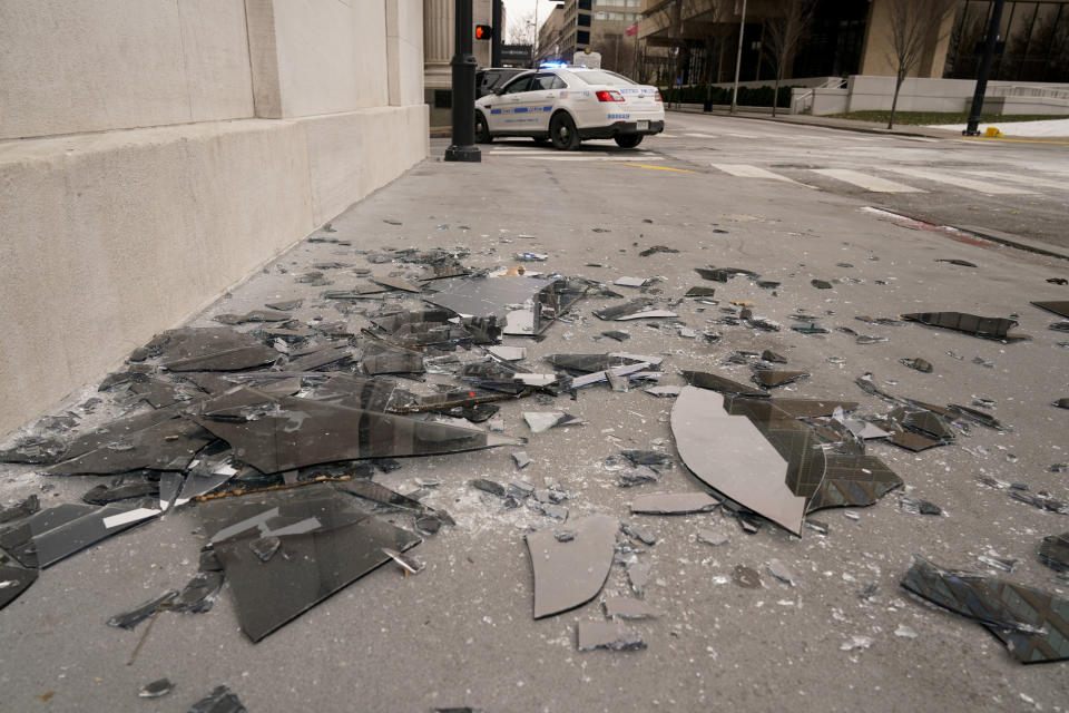 Broken window glass is scattered near the scene of an explosion in Nashville. Source: AP
