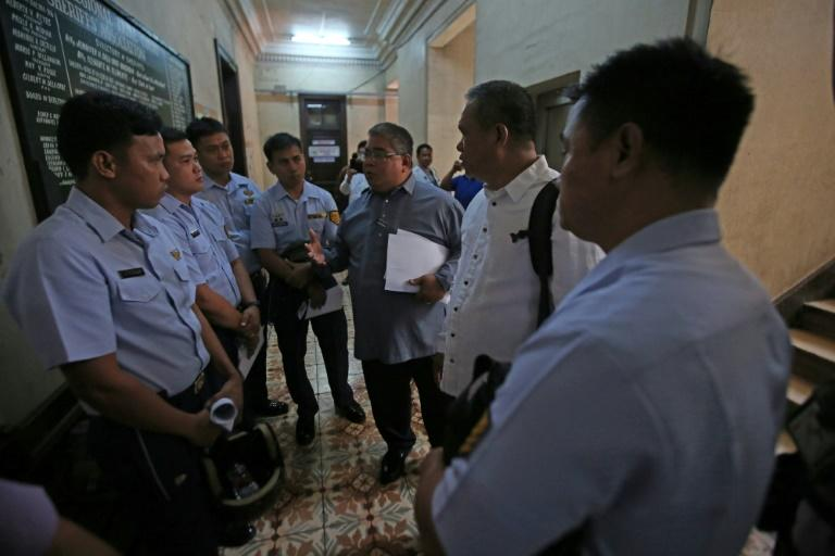 A Manila court convicted the men of homicide and sentenced them to a minimum of eight years in prison (AFP Photo/STR)