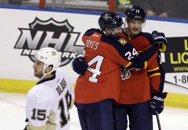 Florida Panthers' Aleksander Barkov (16) is congratulated by teammate Brad Boyes (24) after scoring against the Pittsburgh Penguins in the second period of an NHL hockey game as Penguins' Tanner Glass (15) skates away on Friday, Oct. 11, 2013, in Sunrise, Fla. (AP Photo/Alan Diaz)
