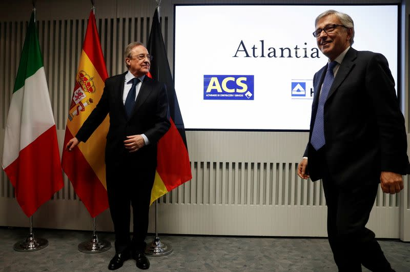 FILE PHOTO: Perez, chairman of Spanish builder ACS, and Castellucci, Atlantia CEO, stand before a news conference in Madrid
