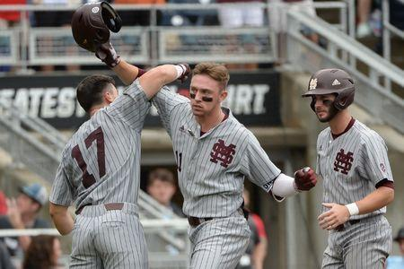 Jun 19, 2018; Omaha, NE, USA; Mississippi State Bulldogs designated hitter Jordan Westburg (11) celebrates a grand slam with third baseman Justin Foscue (17) and shortstop Luke Alexander (7) in the second inning against the North Carolina Tar Heels in the College World Series at TD Ameritrade Park. Mandatory Credit: Steven Branscombe-USA TODAY Sports