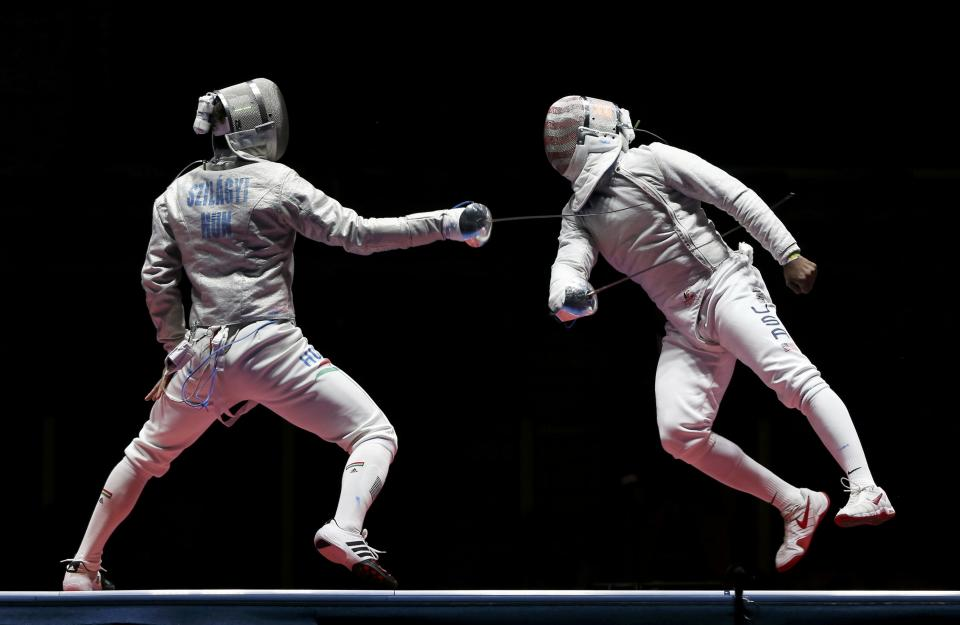 2016 Rio Olympics - Fencing - Final - Men's Sabre Individual Gold Medal Bout - Carioca Arena 3 - Rio de Janeiro, Brazil - 10/08/2016. Daryl Homer (USA) of USA competes with Aron Szilagyi (HUN) of Hungary. REUTERS/Issei Kato FOR EDITORIAL USE ONLY. NOT FOR SALE FOR MARKETING OR ADVERTISING CAMPAIGNS.