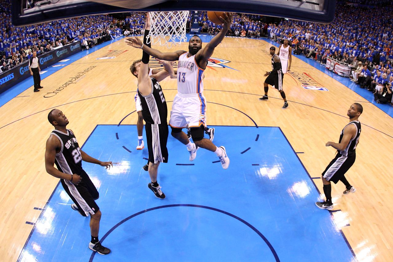 OKLAHOMA CITY, OK - MAY 31:  James Harden #13 of the Oklahoma City Thunder goes up for a shot against Tiago Splitter #22 of the San Antonio Spurs in Game Five of the Western Conference Finals of the 2012 NBA Playoffs at Chesapeake Energy Arena on May 31, 2012 in Oklahoma City, Oklahoma. NOTE TO USER: User expressly acknowledges and agrees that, by downloading and or using this photograph, User is consenting to the terms and conditions of the Getty Images License Agreement.  (Photo by Ronald Martinez/Getty Images)